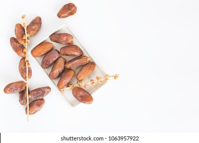 Dates fruit in ceramic bowl white background,Dried date palm fruits top view