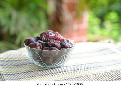 Dates fruit in a glass bowl. Eid Mubarak or Ramadan kareem concept.
