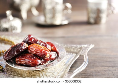Dates fruit and rosary on beautiful tray, close up