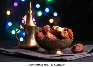 Dates fruit in traditional arabic bowl