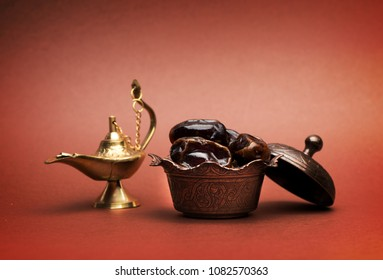 Dates and lamp aladdin on a dark background