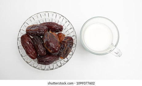 Dates and milk, a sunnah food for all muslim around the world for iftar (break fast). Isolated on white background