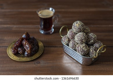 Dates and oatmeal energy balls or bites no cook with espresso black coffee on wooden table healthy food concept for iftar or suhoor  ramadan with copy space