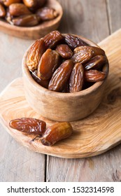 Dates palm fruit in wooden bowl is snack healthy.