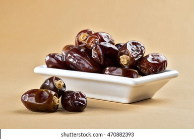Dates in plate. Dried dates fruits.