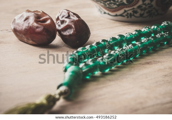 Dates and prayer beads. Celebrating Ramadan.