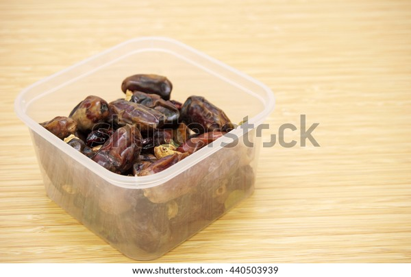dates and slices of figs in a rectangular plastic container.