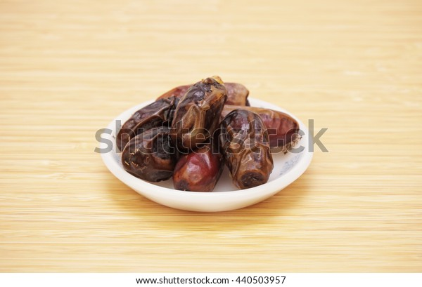 dates in a small plate. close up view.