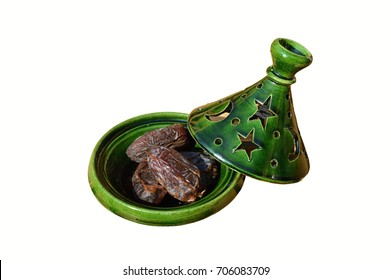 Dates as a snack served in a tagine pot