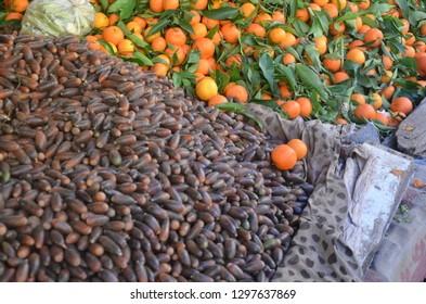 Dates and tangerine that selling at the fez market.