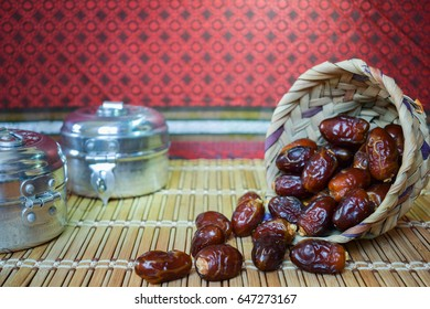Dates in wooden basket made of palm leaves with traditional Arabic background, dates usually Ramadan food for fasting Muslim culture, emarati, emirates & Saudi date healthy with complete nutrition