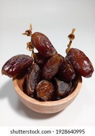 dates in a wooden bowl