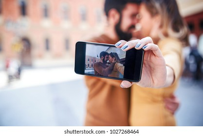 Dating. Loving couple taking a selfie with smart phone. Love and tenderness. Lifestyle concept