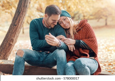 Dating in the park. Romantic couple has beautiful moments of happiness and joy in the autumn park. Love and tenderness. Lifestyle concept