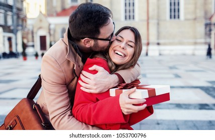 Dating. Young man surprised his girlfriend with a present. Relationships, love