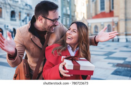 Dating. Young man surprised his girlfriend with a present. Relationships, love, consumerism