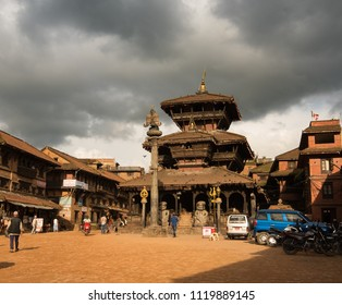 Dattaraya Square, Bakhtapur, Nepal - Circa September 2017 - A perspective shot of Dattaraya Square overlooking Bhimsen Temple with both unidentified local and foreign tourists visiting