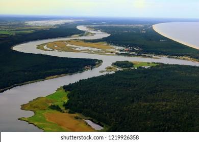 The Daugava river flows into the Gulf of Riga, Baltic sea, near Riga, Latvia