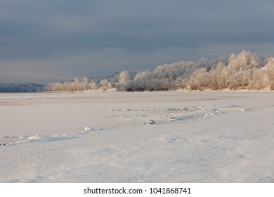 Daugava river landscape with river bends, snow covered ice and trees covered in hoarfrost in Koknese area, Latvia