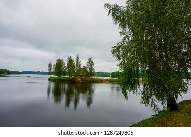 Daugava River near Koknese. Island with sauna in Daugava river. Landscape with birch at Daugava coast. Classical Latvian landscape. Latvian countryside. View of little island in river Daugava, Latvia.