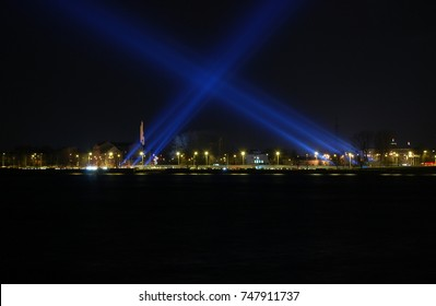 "Daugava waterfront in first light festival ""Staro Riga"" back in 2008, laser beams indicating the shape of upcoming Latvian National Library"