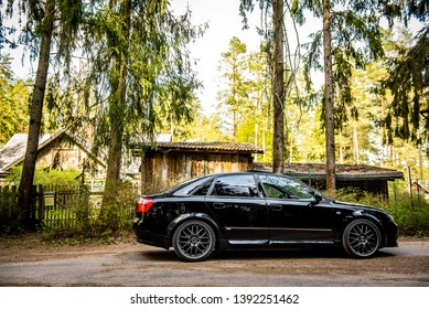 Daugavpils, Latvia - 05.01.2019: Audi A4 S4 B6 in the summer, green forest in the village