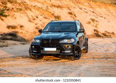 Daugavpils, Latvia - 10.23.2018: BMW X5 M-power in a sandy career