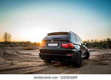 Daugavpils, Latvia - 10.23.2018: BMW X5 M-power in a sandy career  (inscription under the number is autoevacuation)