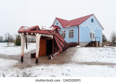DAUGAVPILS, LATVIA - DECEMBER 2018: Entrance of house, decorated with built head of dragon.