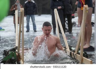 DAUGAVPILS, LATVIA - January 19, 2015: Orthodox church Holy Epiphany Day. Weather -15. People bathed in the ice-hole on Epiphany
