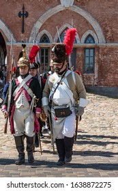 Daugavpils, Latvia - July 20, 2019 : Re-enactment festival Dinaburg 1812. Re-enactors of Napoleonic army marching with their rifles with in Dinaburg Fortress built in 19th century against Napoelon.