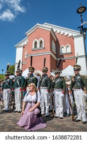 Daugavpils, Latvia - July 20, 2019: Re-enactment festival Dinaburg 1812  in Dinaburg Fortress. Re-enactors of Russian Imperial army of Napoleonic era posing in front of neo-gothic building.