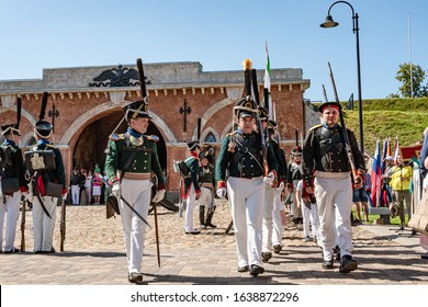 Daugavpils, Latvia - July 20, 2019: Re-enactment festival Dinaburg 1812  in Dinaburg Fortress built in 19th century. Re-enactors of Russian Imperial army of Napoleonic era marching with their rifles.