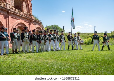 Daugavpils, Latvia - July 20, 2019: Re-enactment festival Dinaburg 1812  in Dinaburg Fortress built in 19th century. Re-enactors of Russian Imperial army of Napoleonic era marching next to ruins.