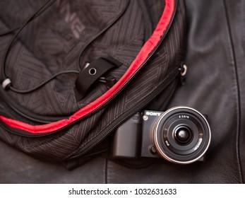 Daugavpils, Latvia - November 11, 2011: Sony Nex camera in the Dakine backpack pocket