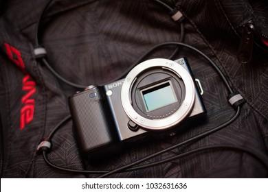 Daugavpils, Latvia - November 11, 2011: Sony Nex camera without lens on the Dakine backpack, open sensor