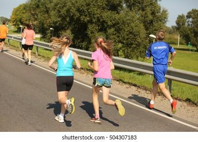 DAUGAVPILS, LATVIA - September 11, 2016: Running people in Daugavpils (Latvia). Mezciems Run - 2016