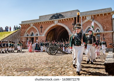 Daugavpils, Latvia-July 20, 2019:Re-enactment festival Dinaburg 1812 in Dinaburg Fortress. Re-enactors of 19th century Russian Imperial army of Napoleonic era marching on in front of Nicholas Gate.
