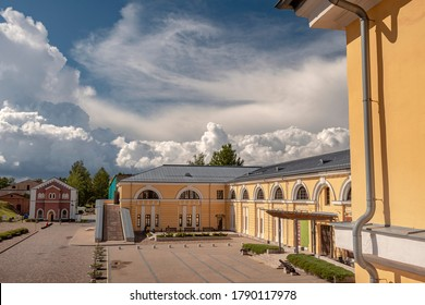 Daugavpils/Latvia - 07.22.2020: Impressive rain clouds above Fortress. Former Artillery arsenal built in Empire style in 1830s. Mark Rothko Art Centre novadays. In the background - Water lifting house