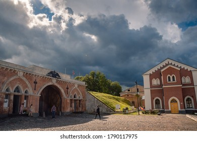 Daugavpils/Latvia-07.22.2020: Daugavpils Fortress. Restored Neo-Gothic Nicholas Gate (built in 1827) and information centre of the Fortress - former water lifting house or watertower (built in 1866).
