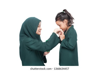 Daughter asking for forgiveness from mother during Raya, a muslims festive celebration
