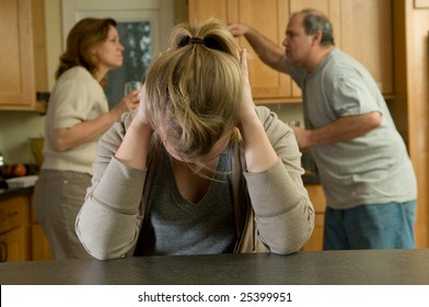 Daughter covers ears as parents fight