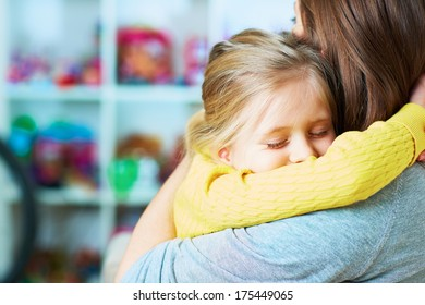 Daughter embrace mother. Sleep. Closed eyes. Home portrait.