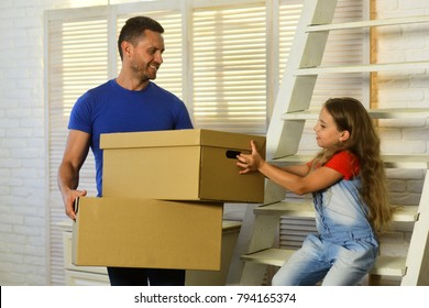 Daughter and father hold boxes and unpack or pack. Girl and man with smiling faces in room with ladder and window on background. Moving and family concept. Kid and guy move into new home or move out