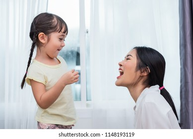 Daughter feeding mom with potato chip funny. Back to school and Education concept. Children and kids theme. Home sweet home and Nursery theme.