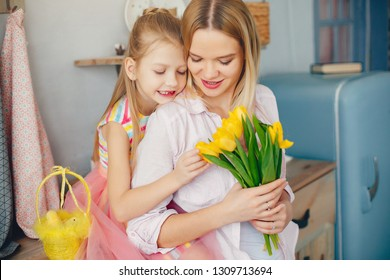 Daughter give mother flowers. Family at home. Mother's day