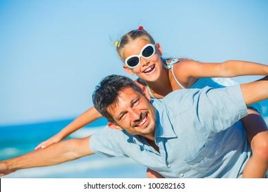 daughter having fun on tropical beach
