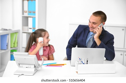 Daughter helping father working in office