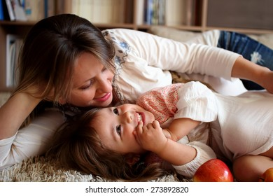 Daughter with her mother laughing and cuddling with happy faces