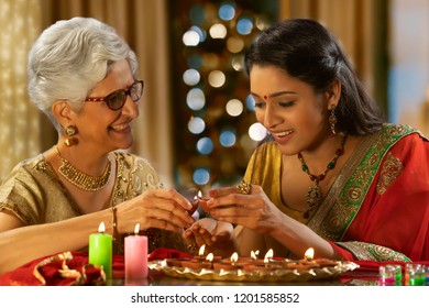 Daughter in law decorating the house with mother in law on the occasion of Diwali